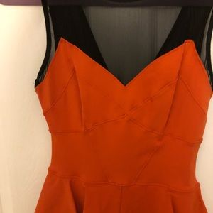 bebe Dresses - Bebe peplum orange dress